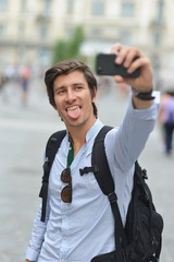Student / tourist taking self portrait on the europe street