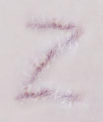 Scar letter Z on human skin