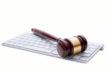 Wooden gavel on a white computer keyboard