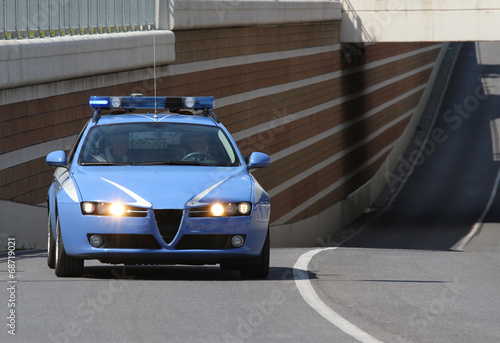 canvas print picture police car running fast while the patrol road