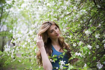 Beautiful woman in garden.