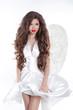 Long wavy Hair. Model Angel Girl in blowing dress with white win