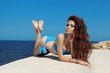 Summer portrait beautiful woman in bikini with makeup and long w