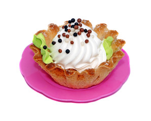 Cake basket with white cream decorated with small balls
