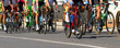legs of cyclists who ride during the race - 68721289