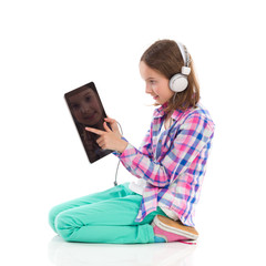 Little girl using a digital tablet.