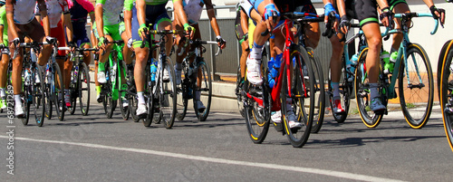 Staande foto Fietsen legs of cyclists who ride during the race