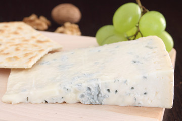Gorgonzola blue cheese on wooden chopping board