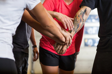 Athletes Stacking Hands At Gym