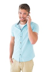 Handsome young man talking on his smartphone