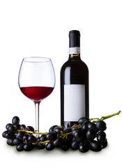 Red wine in the glass and bottle with grape isolated on white.