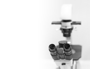 microscope in the laboratory, background with a field for text