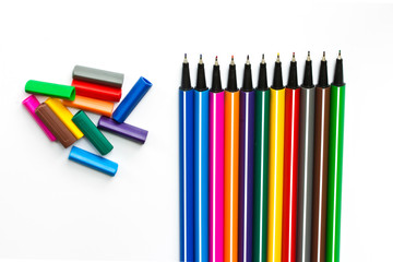 Colorful pens on white background