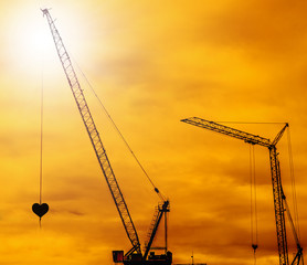 Industrial construction cranes silhouettes sunset
