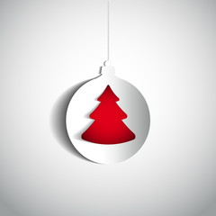 Christmas ball and tree made from papercut on white background,