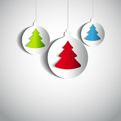 Three Christmas balls with tree made from papercut on white back