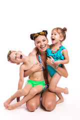 Adorable happy two children with her mother on a white backgroun