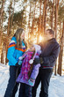 happy family in winter forest