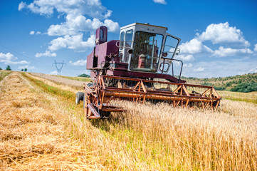 old combine corn and wheat harvester. Agriculture industry