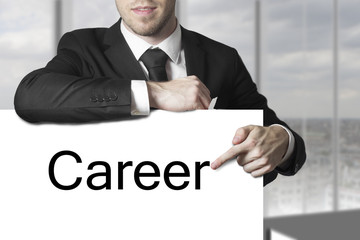 businessman pointing on sign career