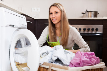 woman with linen basket near washing machine