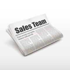 sales team words on newspaper