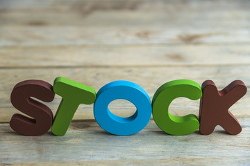 Colorful wooden word Stock on wooden floor