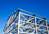 metal frame of the roof against the blue sky - 68728892