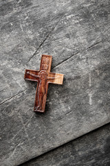 Wooden cross on a wooden background