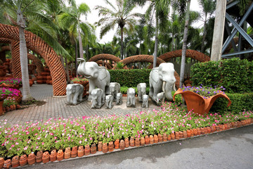 Elephants and flowers and pots in Nong Nooch tropical garden