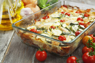 Zucchini baked i with chicken, cherry tomatoes and herbs