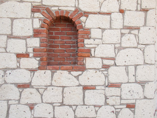 detail of  brick portal in stone wall