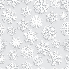 Seamless pattern of paper snowflakes on gray