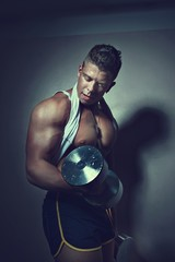 Guy doing exercises with dumbbells