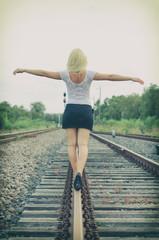 Attractive blond woman posing on railway.