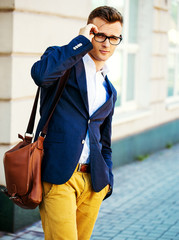 Fashion portrait of a young casual man looking  at the camera. S
