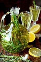 Green estragon lemonade pitcher a wooden table