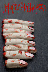 Halloween concept : fingers in blood on a dark background