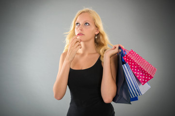 attractive blond woman with shopping bags forgot something