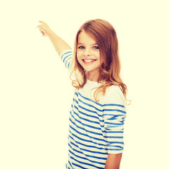 smiling girl pointing at virtual screen