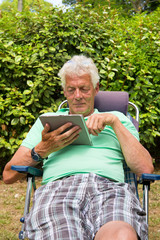 Senior man with digital tablet