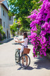 Young beautiful woman with map of the island bicycling