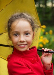 portrait of smiling cute girl with umbrella outdoor