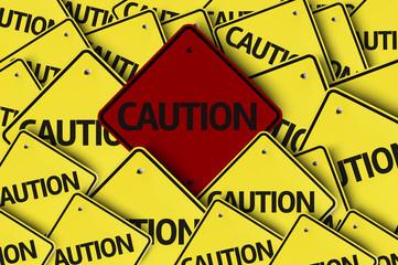 Caution written on multiple road sign