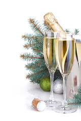 Champagne, blue firtree and christmas decor