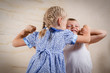Small girl and boy fighting