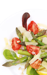 Asparagus salad with tomatoes and parmesan.