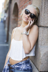 Young casual girl talking in the phone