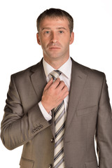 Businessman corrects his tie