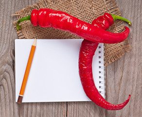 hot peppers and a notebook
